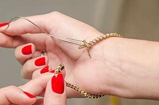 help fasten a bracelet