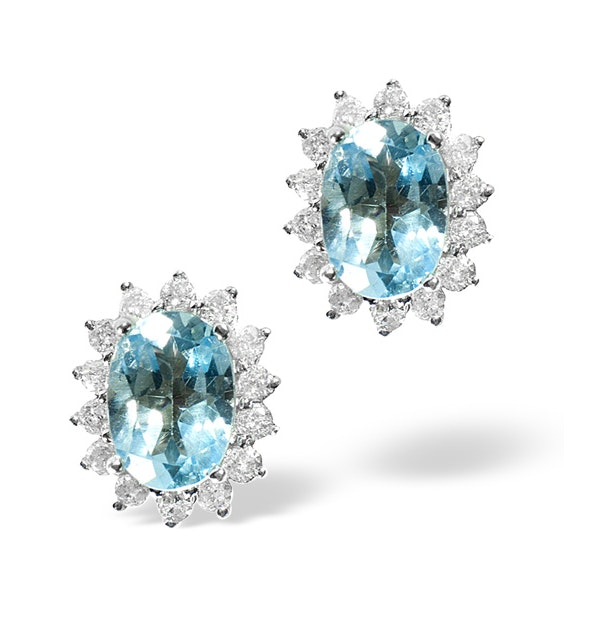 Blue Topaz 7 x 5mm And Diamond 9K Gold Earrings - image 1